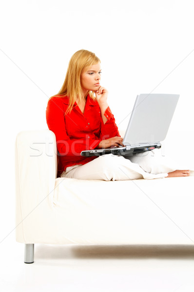 Women with laptop on couch Stock photo © dash
