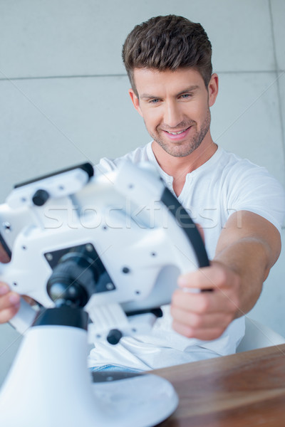 Handsome Middle Age Man Playing Cool Gadget Stock photo © dash