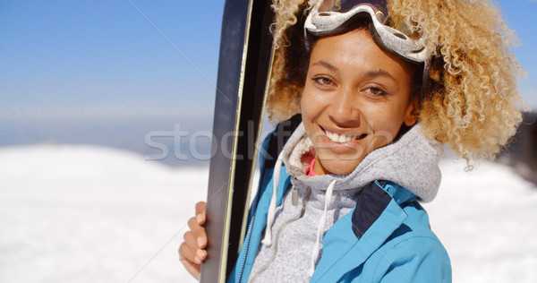 Thoughtful young woman standing holding her skis Stock photo © dash