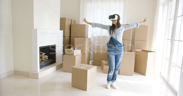 Happy young woman enjoying her VR headset Stock photo © dash