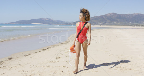 Kobiet ratownik spaceru plaży czerwony Zdjęcia stock © dash