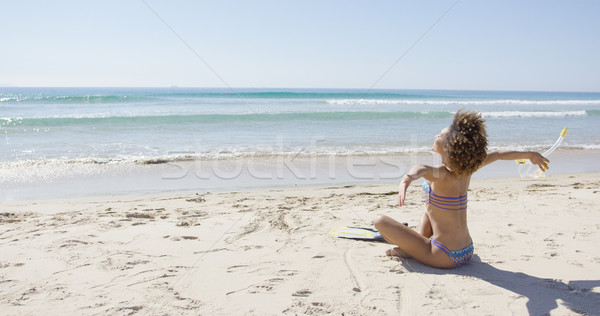 Female sitting with arms outstretched to sides Stock photo © dash