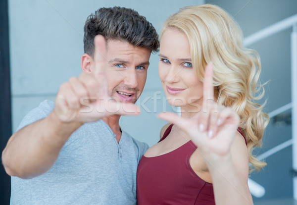 Close up Sweet Young White Couple Looking at Cam Stock photo © dash