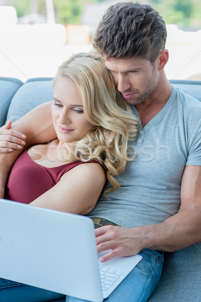 Sweet Middle Age Couple Watching Movie at Laptop Stock photo © dash