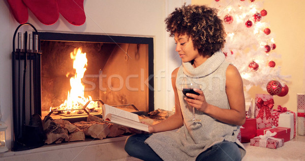 Young woman reading a drinking red wine Stock photo © dash