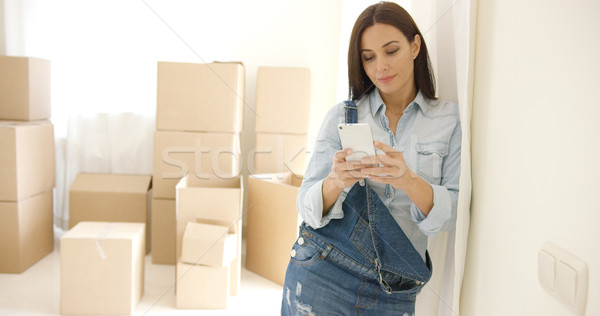 Young woman doing renovations checking messages Stock photo © dash