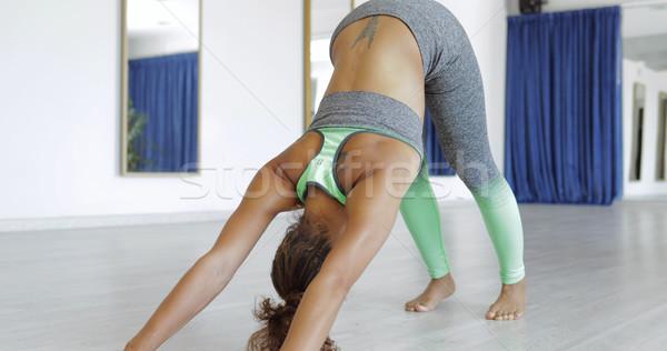 Woman practicing yoga in studio Stock photo © dash