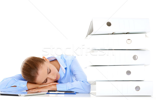 Tired businesswoman asleep at her desk Stock photo © dash