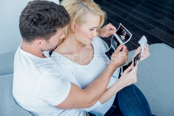 Sweet Couple Looking Ultrasound Result Together Stock photo © dash