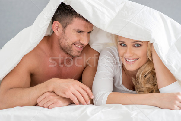 Close up Middle Age Romantic Couple on Bed Stock photo © dash