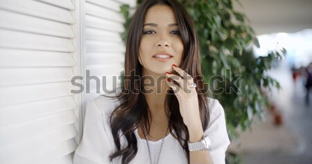 Attractive young woman framed by palm leaves Stock photo © dash