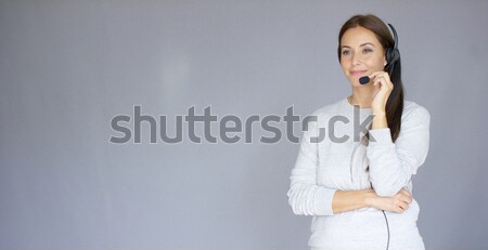 Beautiful and positive female call center agent at work Stock photo © dash