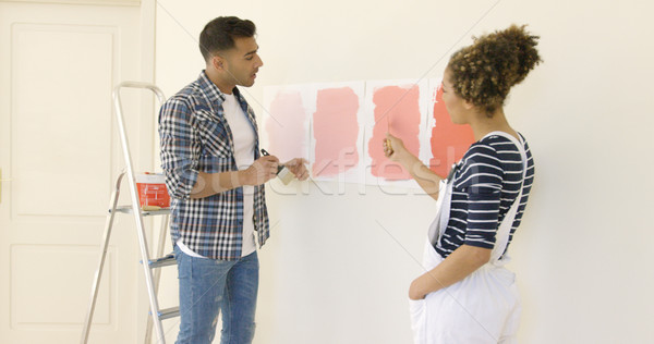 Young couple debating a new paint color Stock photo © dash