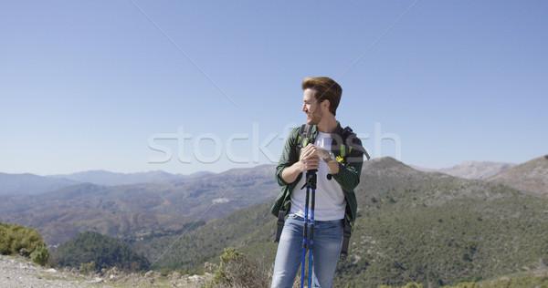 Jeunes Homme trekking jeune homme sac à dos Photo stock © dash
