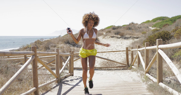 Beautiful girl dancing on coast Stock photo © dash