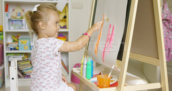 Stock photo: Cute little blond girl painting with watercolors