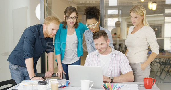 People watching laptop together Stock photo © dash