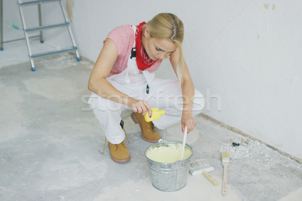 Woman mixing wall paint in bucket  Stock photo © dash
