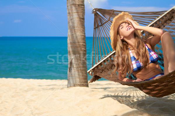 Vonzó nő megnyugtató függőágy bikini arc hát Stock fotó © dash