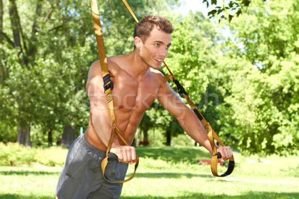 Muscular man doing stretch exercises Stock photo © dash
