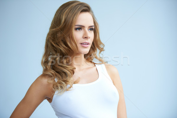 Cute young lady looking her left Stock photo © dash