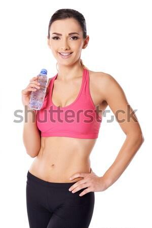 Gyönyörű női atléta ivóvíz iszik merő Stock fotó © dash