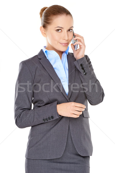 Businesswoman on her mobile phone Stock photo © dash
