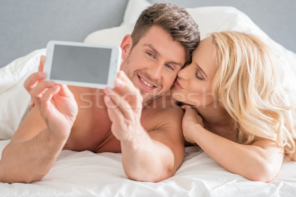 Romantic Couple Capturing Moments Stock photo © dash