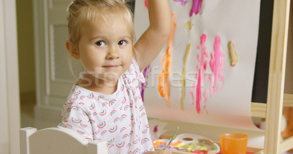 Pretty confident little girl painting at home Stock photo © dash