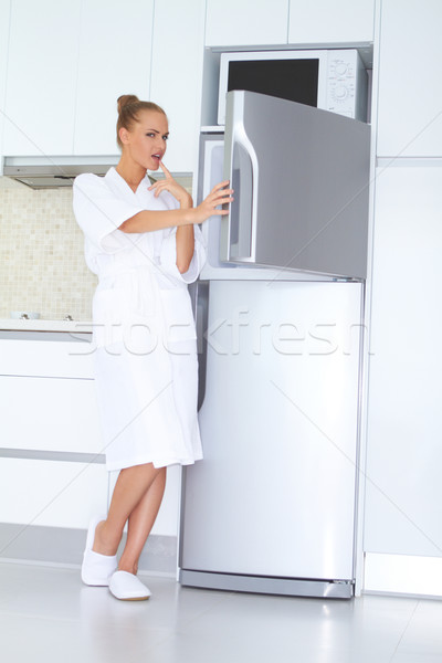 Vivacious woman in bathrobe and slippers Stock photo © dash