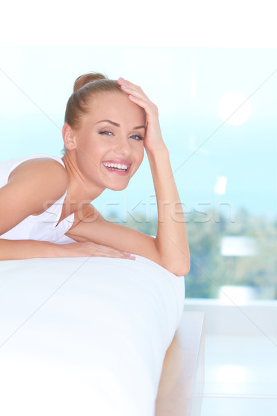 Laughing woman looking over back of sofa Stock photo © dash