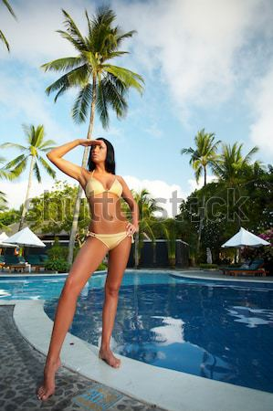Female Model With Afro Haircut Next to Pool Stock photo © dash