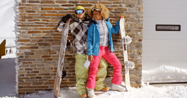 Close couple posing with snowboards against garage Stock photo © dash