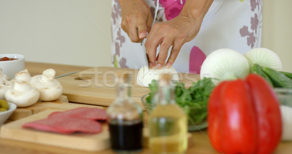 Close up on hands Cutting fresh onion Stock photo © dash