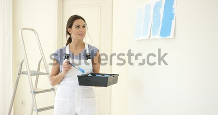 Serious young female artist painting outdoors Stock photo © dash