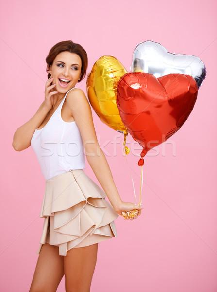 Vivacious woman with heart shaped balloons Stock photo © dash