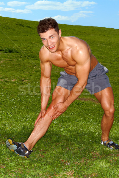 Handsome man doing stretch exercises Stock photo © dash