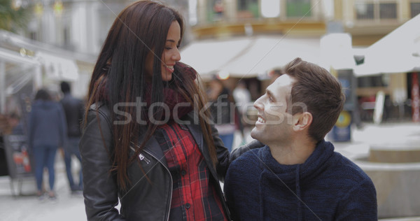 Young couple chatting at a street market or fair Stock photo © dash