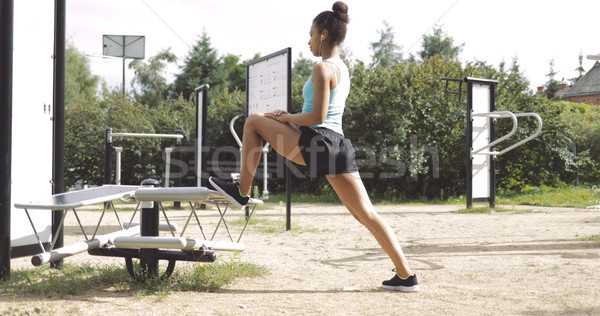 Sportive woman stretching in park Stock photo © dash