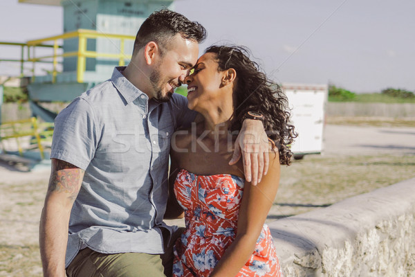 Happy multiracial couple on seafront Stock photo © dash