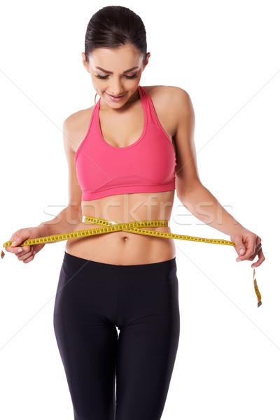 Kadın atlet aşağı bakıyor şerit metre Stok fotoğraf © dash