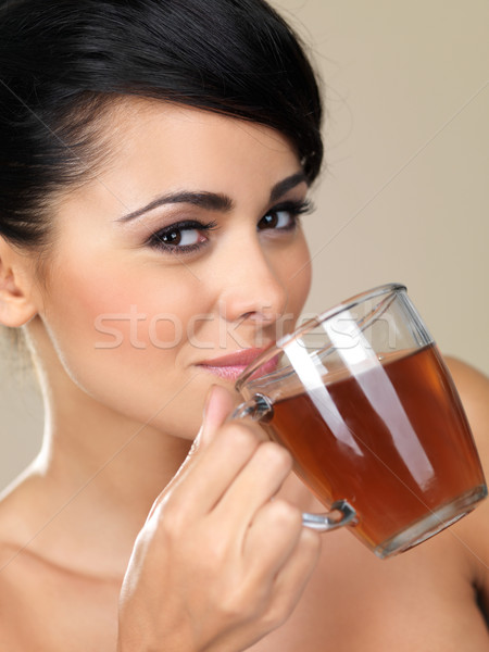 Attractive woman drinking tea Stock photo © dash