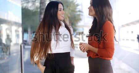 Deux jeunes femmes vers le bas promenade élevé clé Photo stock © dash