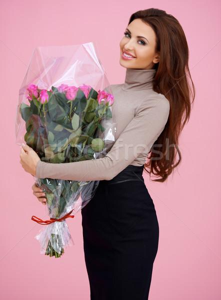 Mutlu kahverengi genç kadın çiçekler uzun Stok fotoğraf © dash