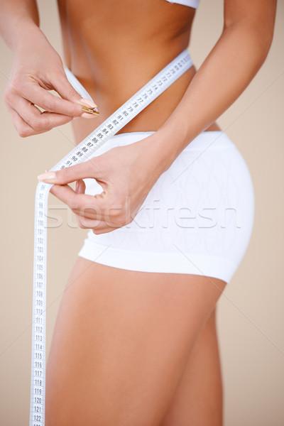Közelkép takaros testrész fehér rövidnadrág nő Stock fotó © dash