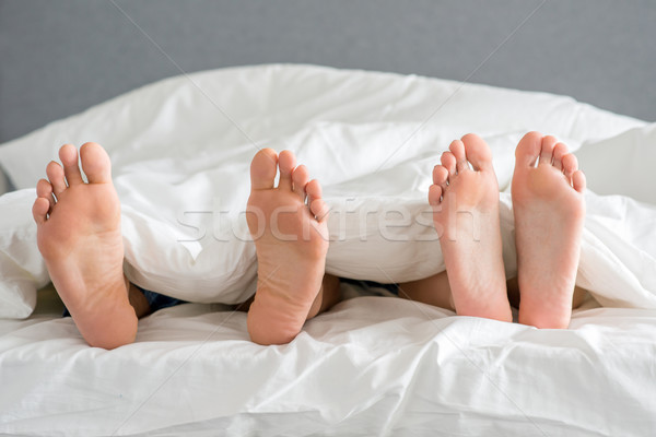 Close up Partners Soles on White Bed Stock photo © dash