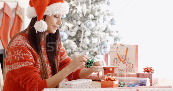 Young woman sitting wrapping Christmas gifts Stock photo © dash