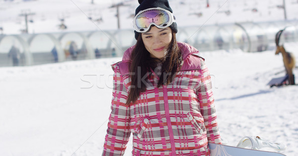 Cute and happy female asian snowboarder Stock photo © dash