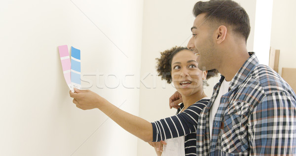 Young couple trying to choose a paint color Stock photo © dash