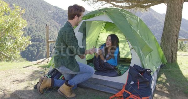 Couple taking rest after trekking Stock photo © dash